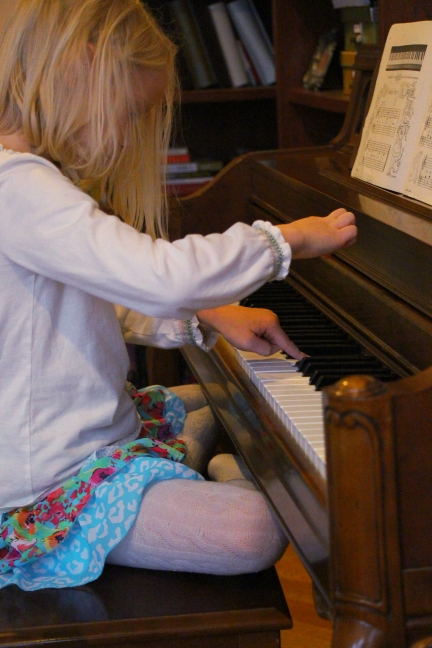 a girl and her piano