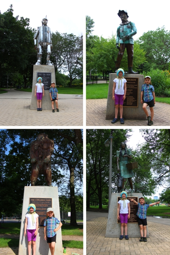 Kids with Wizard of Oz statues